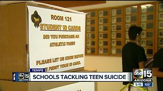 New student IDs provide suicide hotline number on them - Video