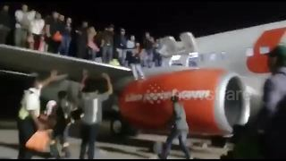 Shocking moment passengers leap from plane after bomb scare