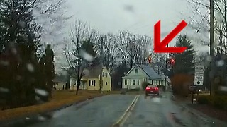 Stopped car runs red light  - Video