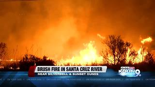 Brush fire burning in Santa Cruz River - Video
