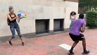 Prankster challenges strangers to water fights on the street