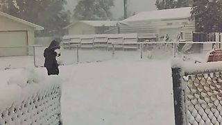 Record Snowfall Leaves Lawn in Havre Blanketed in White - Video