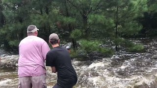 Texas Men Work to Save Dog From Raging Waters - Video
