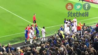 Everton fan tries to hit Lyon goalkeeper while holding his son - Video