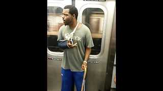 Dude on NY subway freestyles for passengers