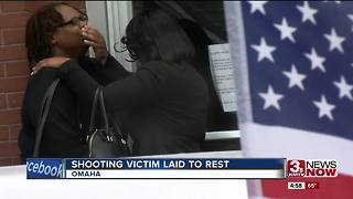 Arrest announced as shooting victim laid to rest - Video