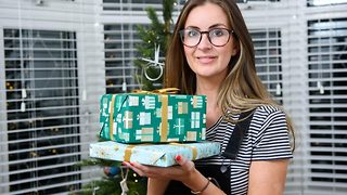 The gift of giving – Woman wraps people's presents for Christmas - Video