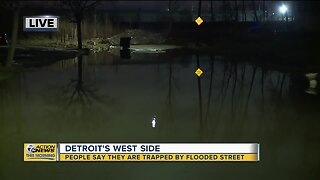 Residents trapped by flooded street on Detroit's west side
