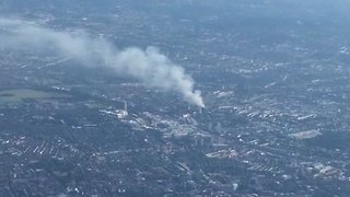 Plume of Smoke Thrown Up by London Tower Fire Captured From the Air - Video