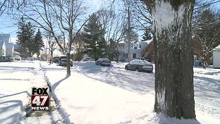 Don't park on side streets until snow is cleared - Video