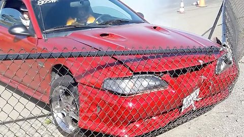 Mustang wally: Experienced drifter crashes into fence after spinning out