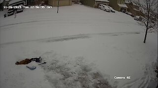 Boy realizes how hard shoveling snow is!