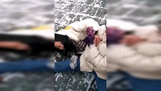 Tourists struggle to walk on slippery snow-covered Great Wall