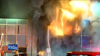 Business building destroyed by fire on north side - Video