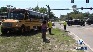 Truck and school bus collide in suburban West Palm Beach - Video