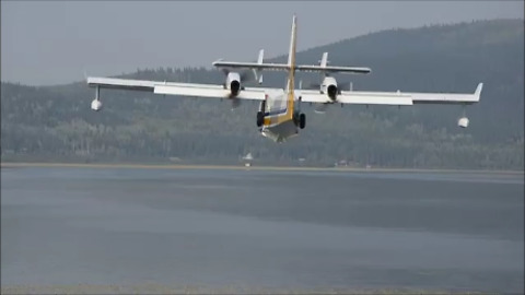 Water Scooping Planes Skim Lake to Fight Fire