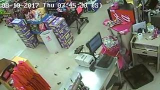 Family Dollar armed robber spends the night inside store - Video