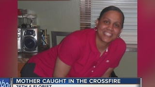Woman killed after getting caught in gunfight crossfire