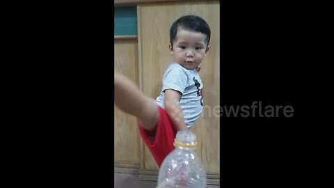 'Woaahh!' Toddler perfectly performs the #BottleCapChallenge