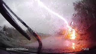 Tree struck by lightning caught on dashcam in Russia