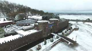 Spectacular Drone Footage of Snowfall Over Kryal Castle - Video