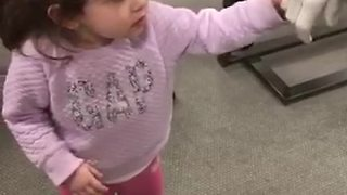 Little Girl Tries To Make Friends With a Mannequin