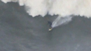 Daredevil Surfer Rides Giant Wave In Portugal - Video