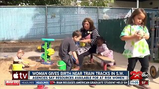 Woman gives birth on railroad tracks