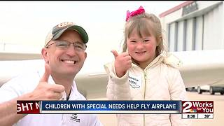 Kids with special needs get to fly in plane - Video