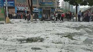 Hailstorm leaves streets in Chinese city covered in thick ice - Video