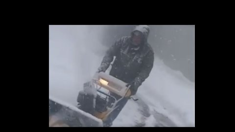 Snow Blower Hard at Work as Heavy Flurries Continue in Grand Rapids