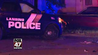 Officer hurt in Lansing crash - Video