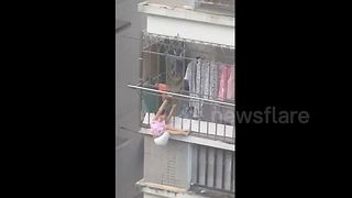 Man Rescues Four-Year-Old Girl Dangling From Balcony - Video