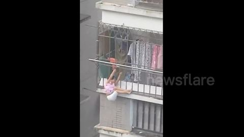 Man Rescues Four-Year-Old Girl Dangling From Balcony