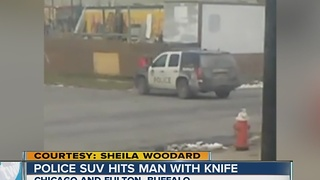 Buffalo police SUV hits man with knife - Video