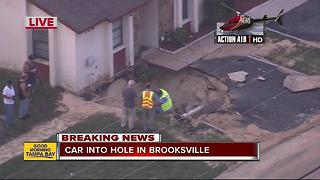 Car falls into hole in Hernando Co. after water main break - Video