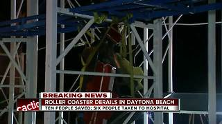 Riders fall 34-feet to the ground from dangling roller coaster car in Florida - Video