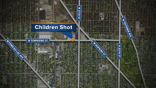 Police: 2 children shot inside car - Video