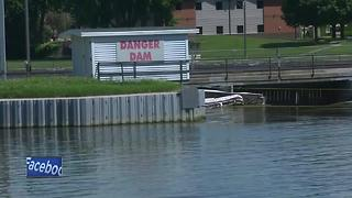 Three people make it to shore after boat becomes stuck in Neenah Dam - Video