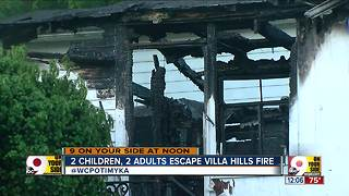 2 children, 2 adults escape fire - Video