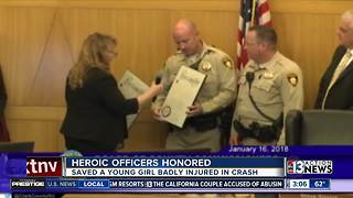 Police officers honored for helping girls - Video