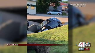 Sinkhole swallows truck, driver in Excelsior Springs - Video