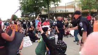 Troy officers take a knee with protesters