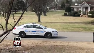Officer plays catch with teen
