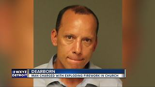 Man charged with detonating firework in church - Video