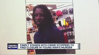 Family stand with Crime Stoppers to find closure in young man's murder - Video