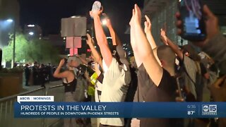 Protesters clash with police in downtown Phoenix