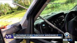 Crowbar smashes through Florida driver's windshield on I-95 in Volusia County - Video