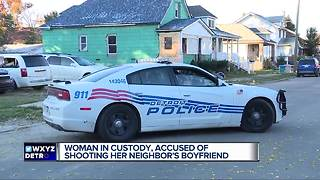 Woman accused of shooting neighbor's boyfriend - Video