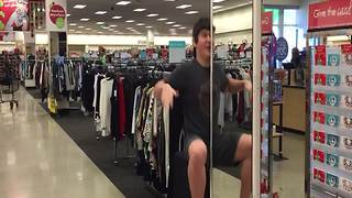 Teen Boy Dances In Front Of A Department Store Mirror - Video
